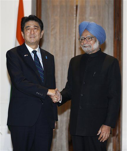 Japanese Prime Minister Shinzo Abe, left, poses with Indian Prime Minister Manmohan Singh for photographers before a meeting in New Delhi, India, Saturday, Jan. 25, 2014. Abe arrived Saturday on a three-day official visit to India and will also be the Chief Guest on India's Republic Day parade, celebrated on Jan. 26. SAURABH DAS — AP Photo