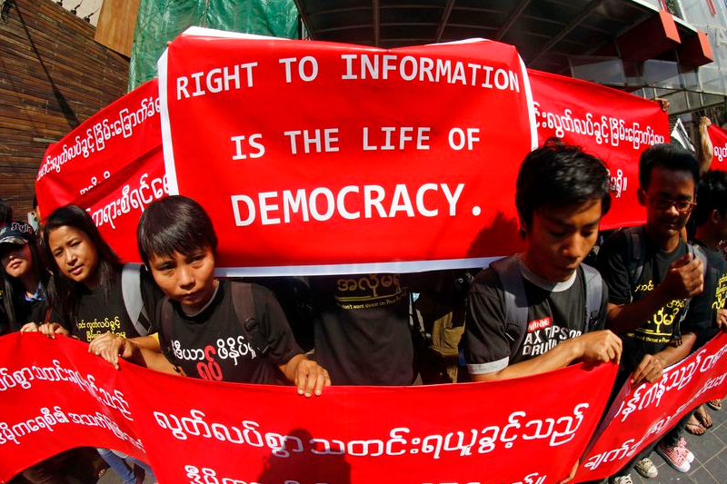 Myanmar journalists hold banners as they protest for press freedom outside office of the Daily Eleven newspaper in Yangon on Jan. 7 in Myanmar. (AP Photo)