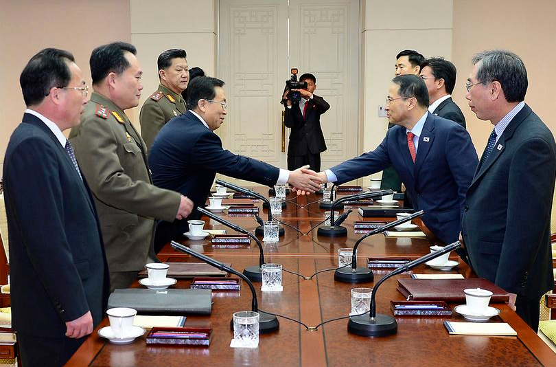 In this photo released by the South Korean Unification Ministry, South Korean chief delegate Kim Kyou-hyun, second from right, shakes hands with his North Korean counterpart Won Tong Yon, third from left, during their meeting at the border village of Panumjom, South Korea on Feb. 12. (AP Photo/ South Korean Unification Ministry)