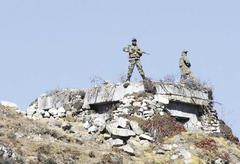 Indian Army personnel stand watch at Bum La Pass at the India-China border in Arunachal Pradesh in October 2012. [AFP/GETTY IMAGES]