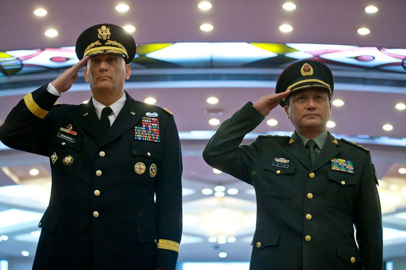 U.S. Army Chief of Staff Gen. Raymond Odierno, left, and Gen. Wang Ning, deputy Chief Staff of the People's Liberation Army (PLA), salute as they review an honor guard at China's Ministry of Defense in Beijing on Feb. 21. (AP Photo/ Pool)