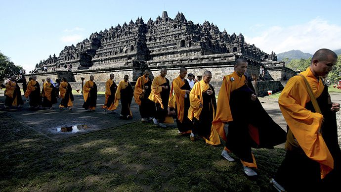 Buddhist monks walk through Borobudur temple during a ceremony on Vesak Day in Magelang in Indonesia's Central Java province (Reuters / Dwi Oblo)