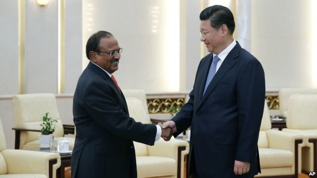 Chinese President Xi Jinping, right, shakes hands with Indian National Security Adviser Shivshankar Menon prior to a meeting at the Great Hall of the People in Beijing, Sept. 9, 2014