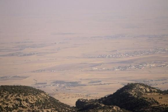 A general view shows Sinjar town which is controlled by forces loyal to the Islamic State as seen from Mount Sinjar August 13, 2014. CREDIT: REUTERS/RODI SAID