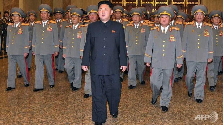 File photo of North Korean leader Kim Jong-Un (C), accompanied by senior army officials. (AFP Photo/KCNA)