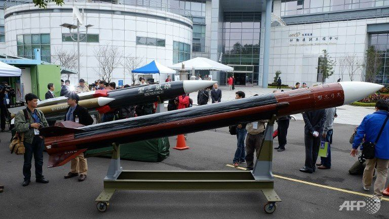 Journalists look at a model of Tienkung III (Sky Bow III) missile (front) and a Hsiungfeng III missile (back) at the Chungshan Institute of Science and Technology in Taoyuan, Taiwan. (AFP PHOTO / SAM YEH)