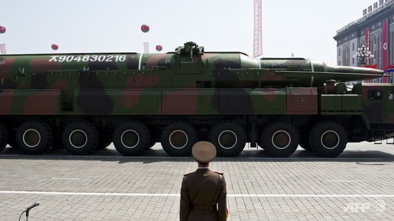 A North Korean soldier stands guard in front of a military vehicle carrying what is believed to be an Intermediary Range Ballistic Missile (IRBM), during a military parade in Pyongyang. (Photo: AFP/File/Pedro Ugarte)