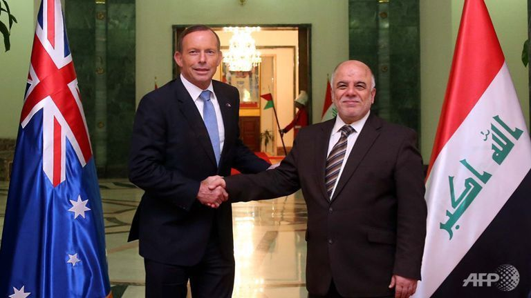 Iraqi Prime Minister Haider al-Abadi (R) greets his Australian counterpart Tony Abbott ahead of a meeting in Baghdad on January 4, 2015. (Photo: AFP/HO/Iraqi Prime Minister's Office)