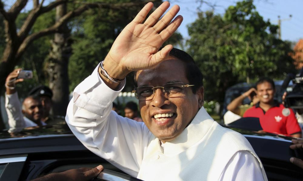 Sri Lanka's president-elect Maithripala Sirisena gestures as he leaves after casting his vote during the presidential elections at a polling station in Polonnaruwa, about 200 kilometers (124 miles) northeast of Colombo, Sri Lanka. Photograph: Sujeewa Kumar/AP