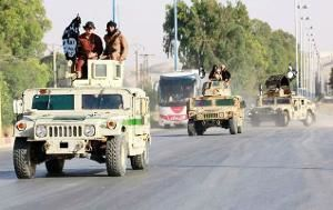 Islamic State jihadists moving in vehicles captured from the Iraqi army.