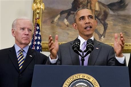 In this Feb. 11, 2015 file photo, Vice President Joe Biden listens as President Barack Obama speaks about the Islamic State group, Wednesday, in the Roosevelt Room of the White House in Washington. White House officials say President Barack Obama is open to negotiating with Congress on many elements of his request for war powers against the Islamic State group, including his proposed three-year time limit on U.S. military action and the use of American troops. (AP Photo/Jacquelyn Martin, File)