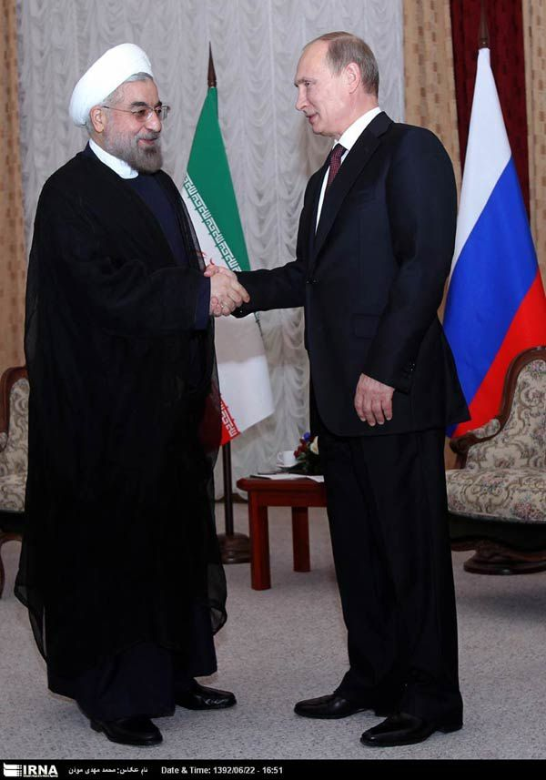 Russian President Vladimir Putin (right) with Iranian counterpart Hassan Rohani in Bishkek.