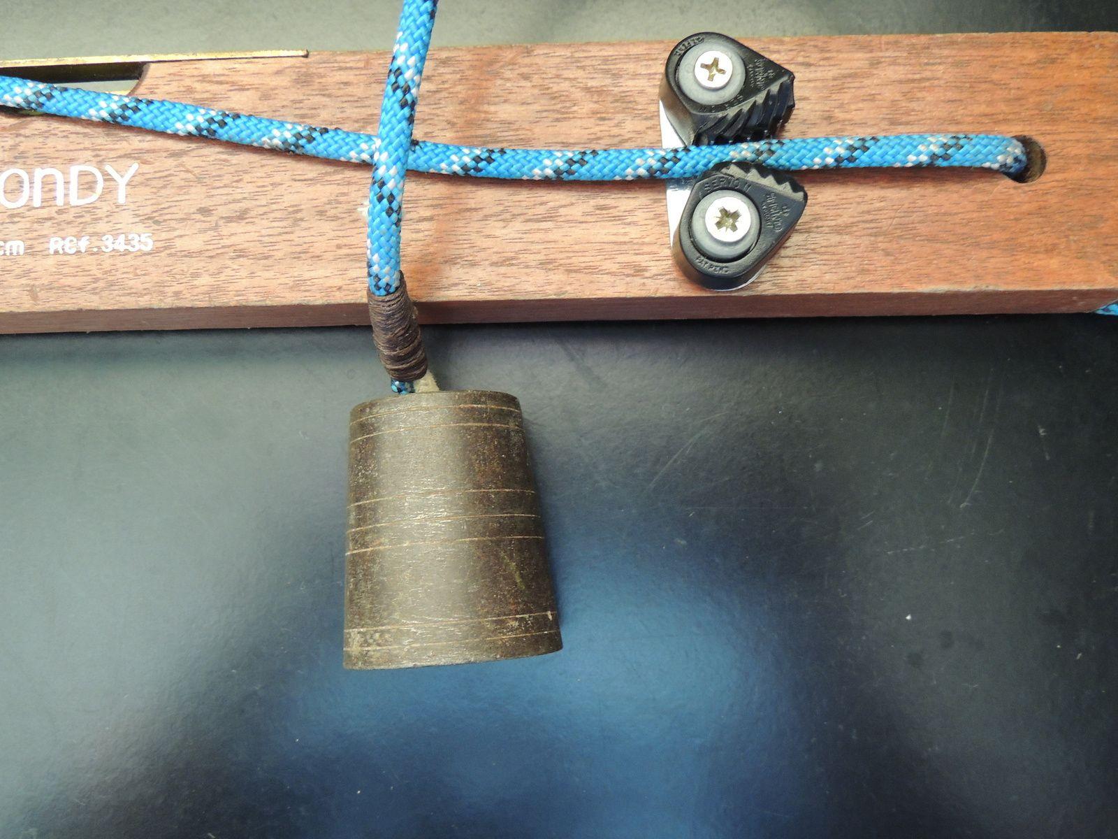 Type de poids utilisé au bout du fil à plomb. Techniques d'élevage 2014. Image soumise à droits d'auteur
