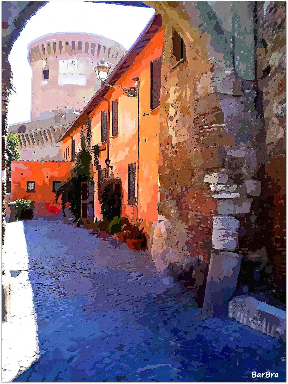 La porta delle mura che cingono il borgo ... sullo sfondo, il castello di Giulio II