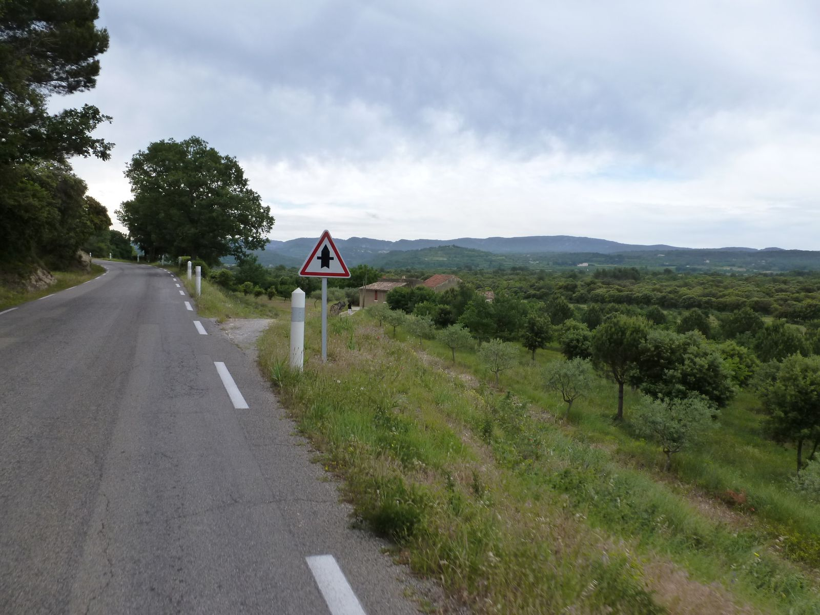 Riding up the first low 'pass' (col, in French) of the day