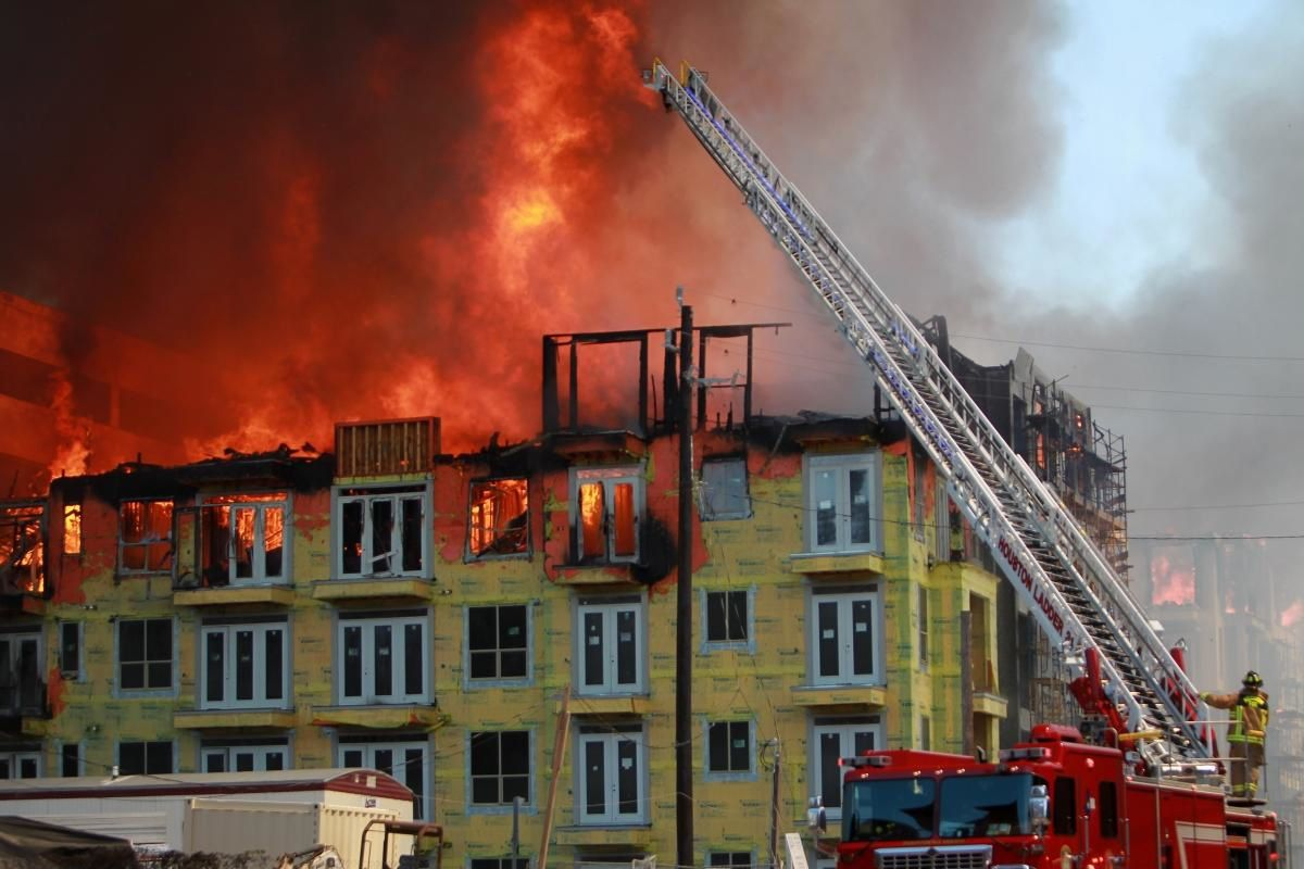 Mayra Beltran/AP The flames completely engulfed the apartment complex, which was under construction when the fire started.