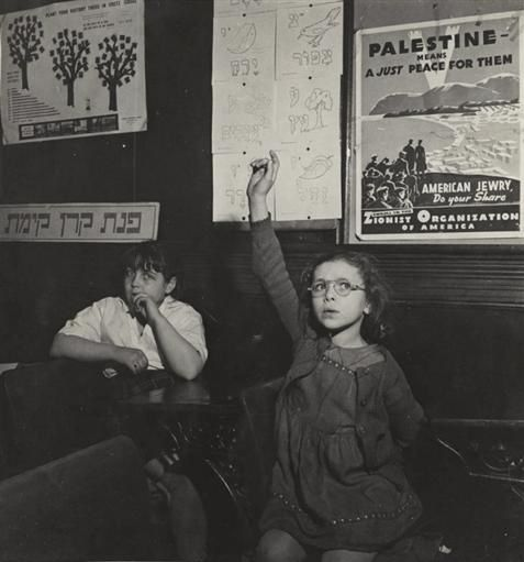 Student raising her hand in Hebrew school, Bronx House, New York, 1942
