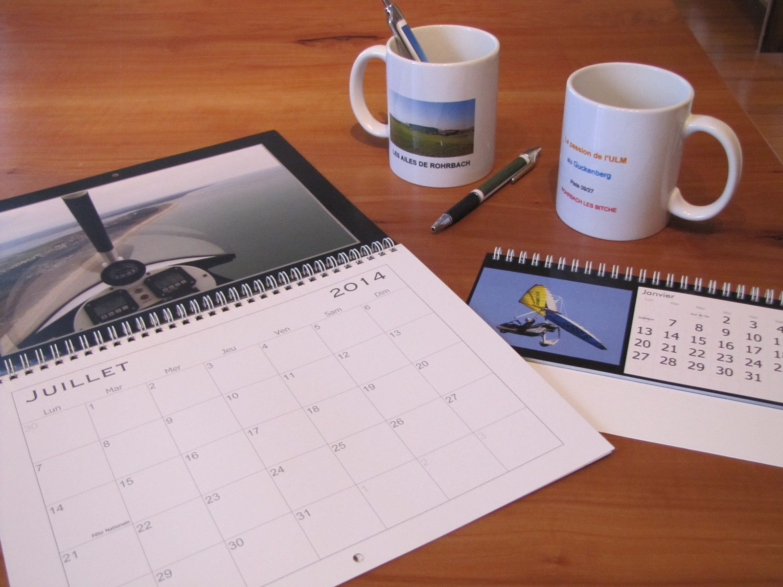 Mugs, calendriers, stylos, livres... pour Les Ailes de Rohrbach!   BONNE ANNEE!