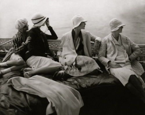 Edward Steichen, Models seated in the back of a yacht, July 15, Vogue, 1928.