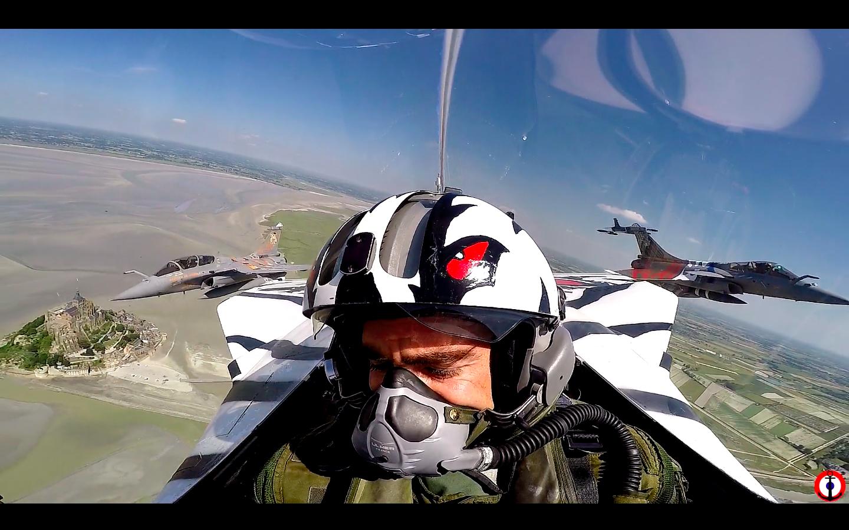 © capture d'écran vidéo - En vol dans le Rafale M de la 11F décoré, avec le Rafale de l'EC 3/30 Lorraine et de l'ECE 1/30 Côte d'Argent.