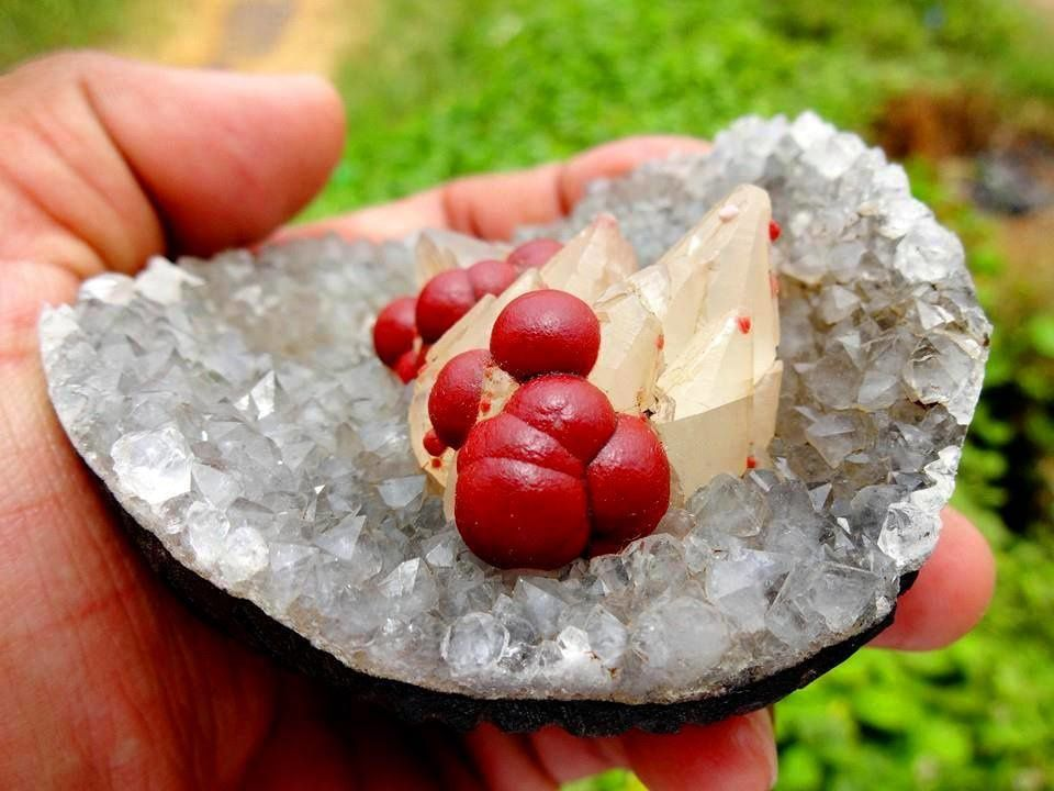 Red Fluorite Ball on Calcite on Geode of Quartz from Mahodari Mine, Nasik, Maharashtra, India (private collection)