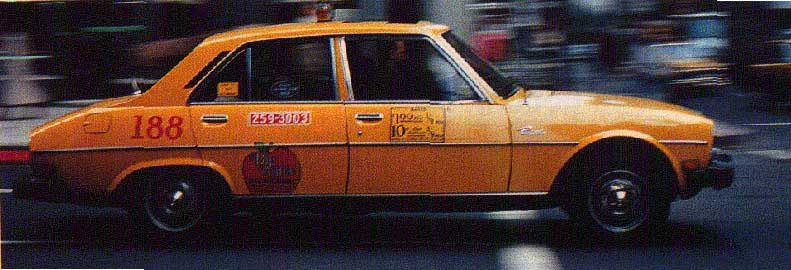 Yellow Peugeot 504 cab in NYC
