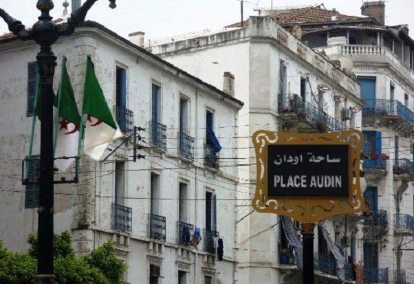 """Alger : Place Audin. """" Lorsque je me rendais chez lui, au 22 rue de Nîmes, au centre d'Alger, pour les cours de mathématiques qu'il me donnait gracieusement, je ne savais pas que j'allais à la rencontre d'un savant, tellement sa modestie était grande. Il me consacra généreusement ses samedis après-midi, alors qu'il préparait sa thèse de doctorat en mathématiques."""" Mohamed Rebah"""