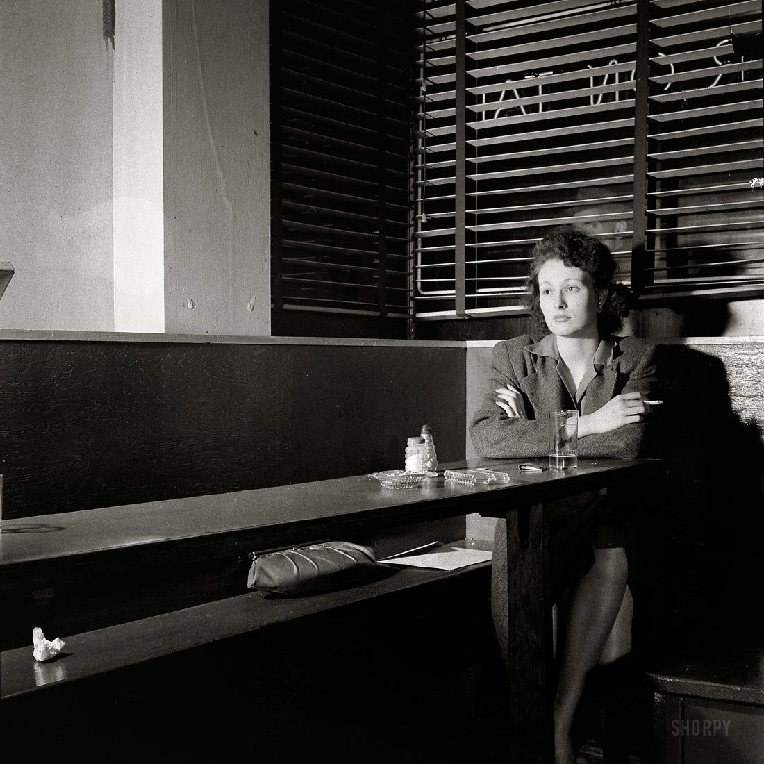Esther Buble, Girl sitting alone in the Sea Grill waiting for a pickup, april 1943 Washington D.C.