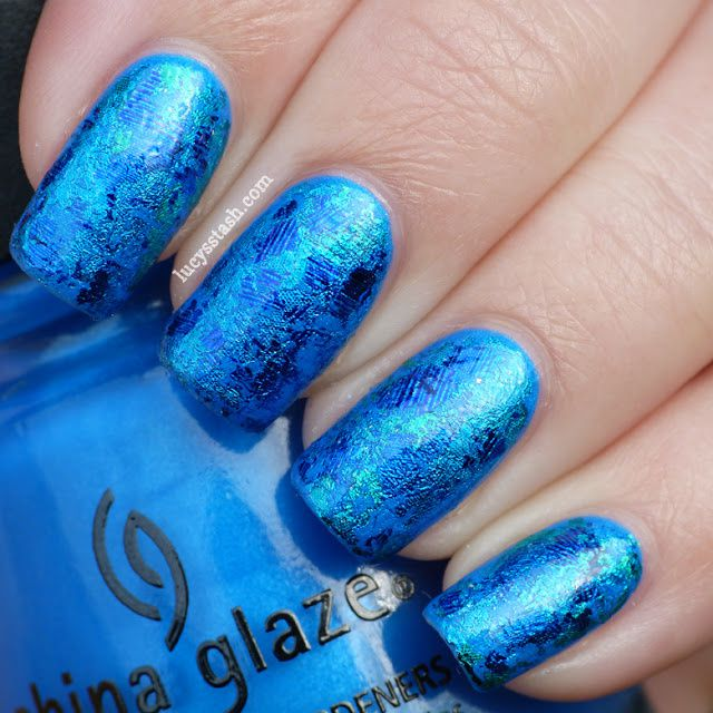 Lucys stash nail art reviews swatches nail tutorials after the glue dried i started dabbing the foil on the nail ive used different shades of blue and blue ish green to create the changing colour prinsesfo Choice Image