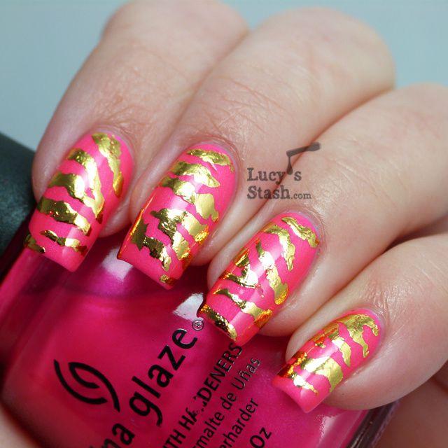 Gold zebra print nail art design