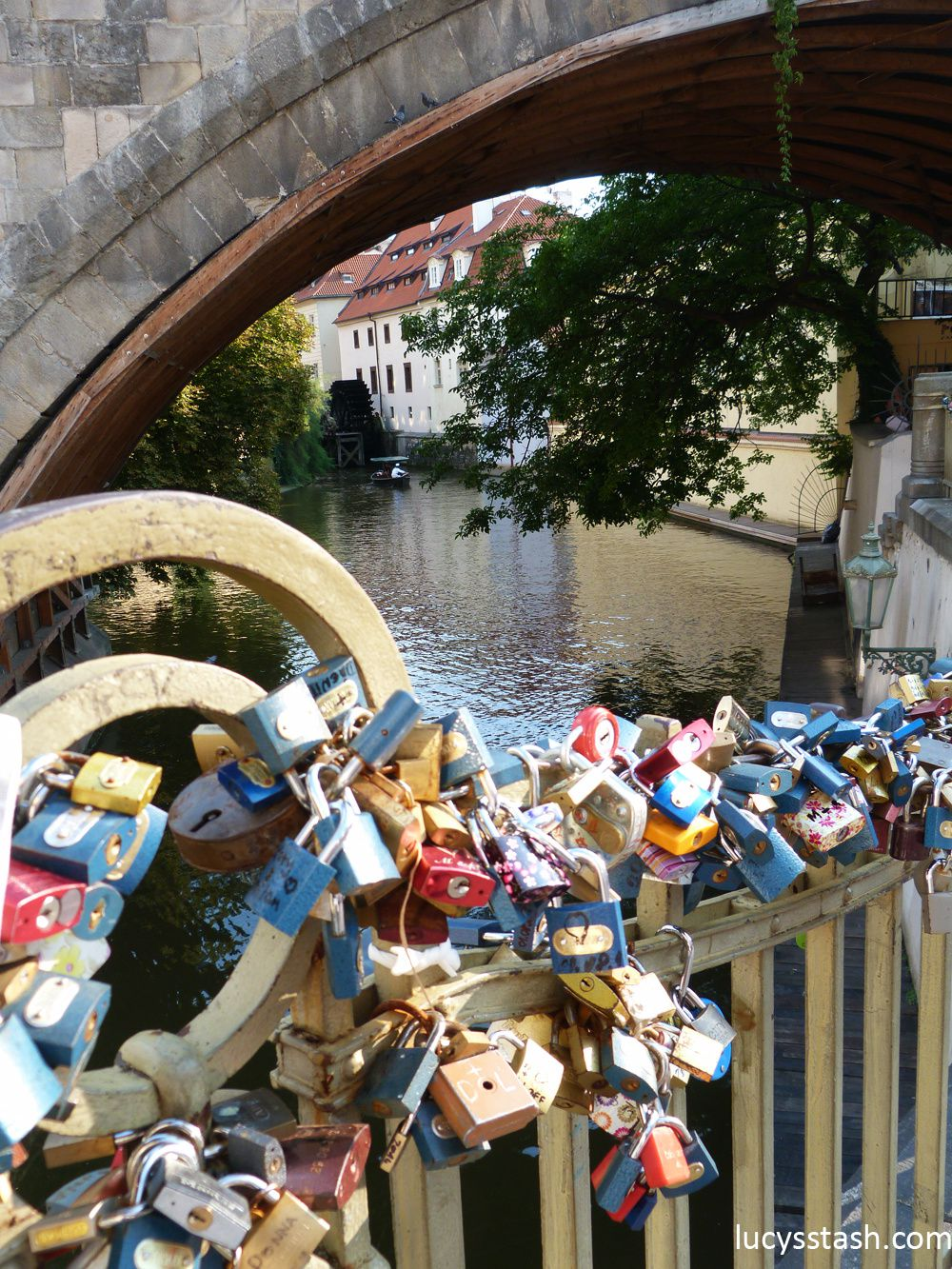 Čertovka river and love locks on the bridge