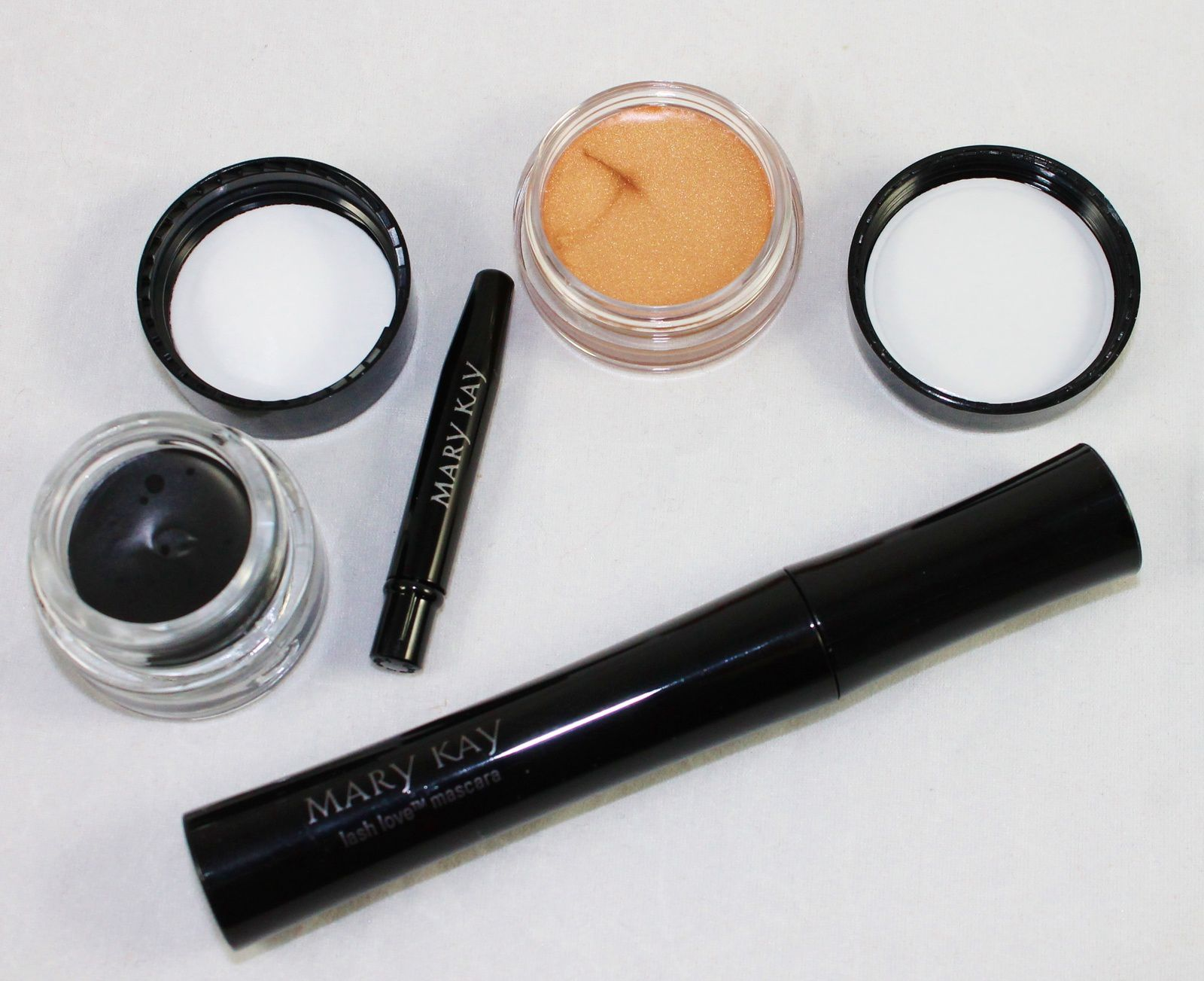 Mary Kay Cream Eye Color in Apricot Twist ($14), Mary Kay Gel Eyeliner with expandable Brush Applicatoir in Jet Black ($18), Mary Kay Lash Love Mascara in Black ($15)