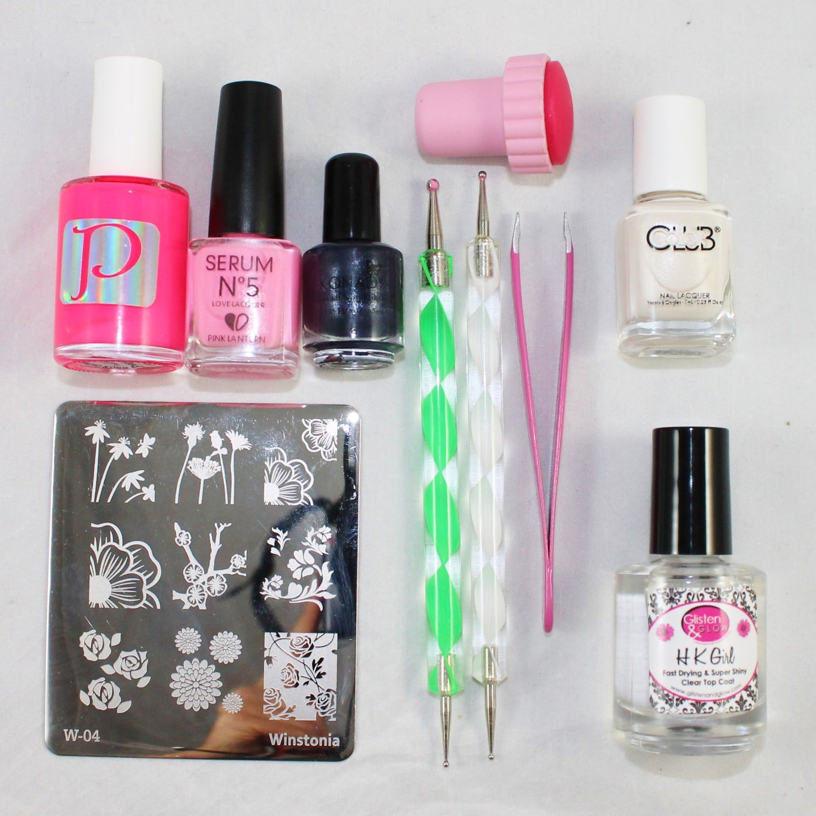 What you need: a stamping plate, a stamper (or more than one if you have more), a stamping polish, some polish and dotting tools to paint the pattern, tweezers, a base polish and a top coat that does not smear.