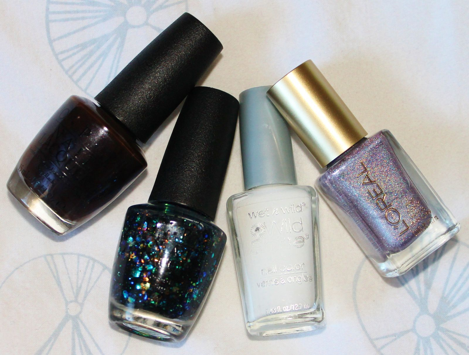 Sally Hansen Complete Care 4-in-1 Extra Moisturizing Nail Treatment / OPI Love is Hot and Coal / L'Oréal Masked Affair / Wet'n Wild White 449C + OPI Comet in the Sky / HK Girl Top Coat