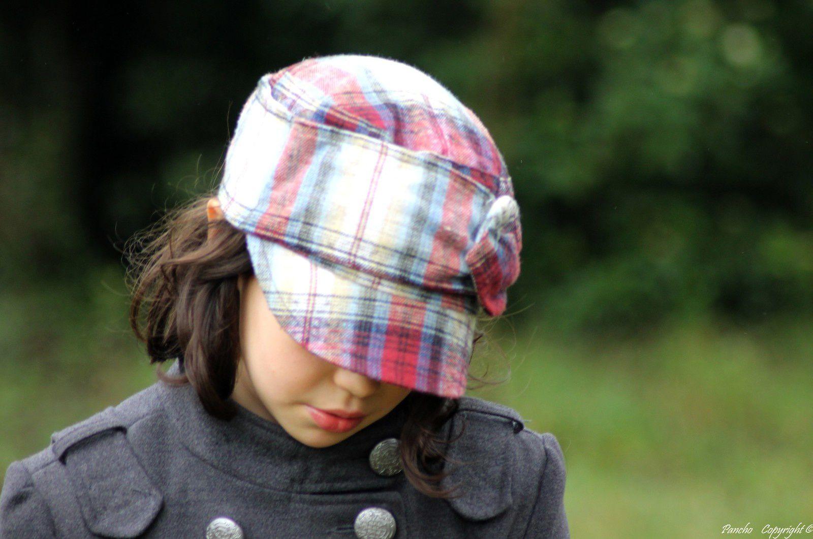 Tête à chapeaux