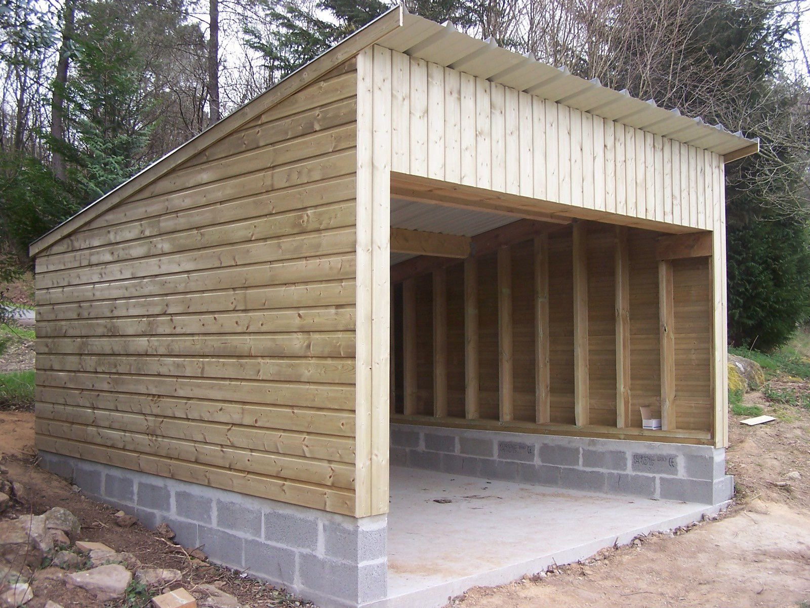 Garage moustoir ac for Construction garage parpaing