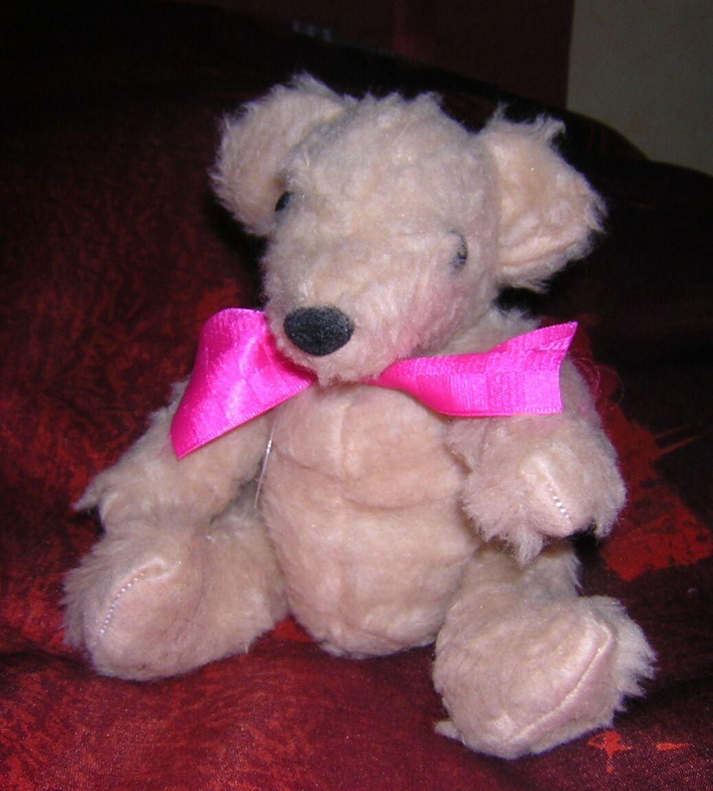 pour Solange, un ours en peluche cousu main!