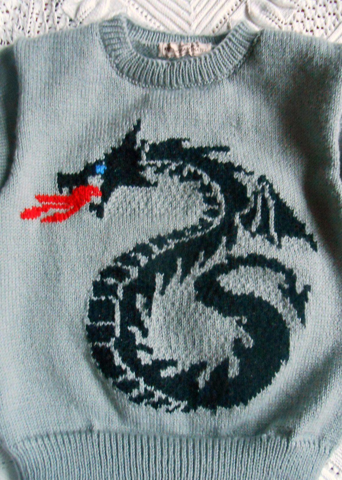 Le pull au dragon qui crache du feu... sinon c'est pas un vrai dragon!