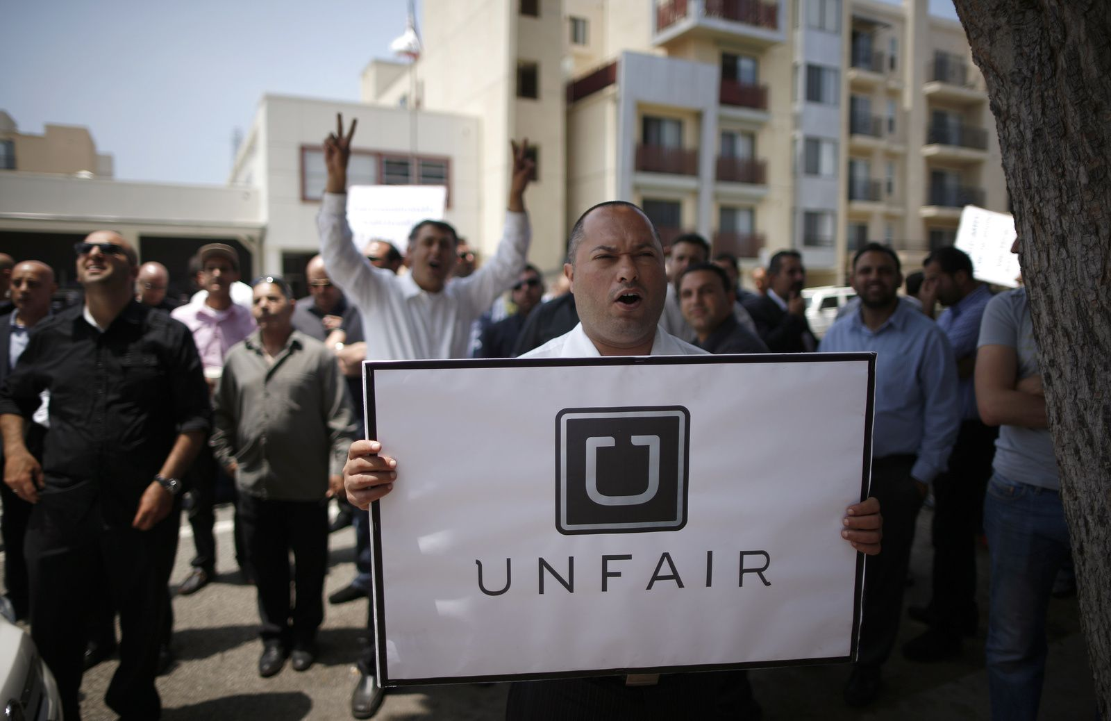http://blogs.reuters.com/great-debate/files/2014/07/uber-protestors.jpg