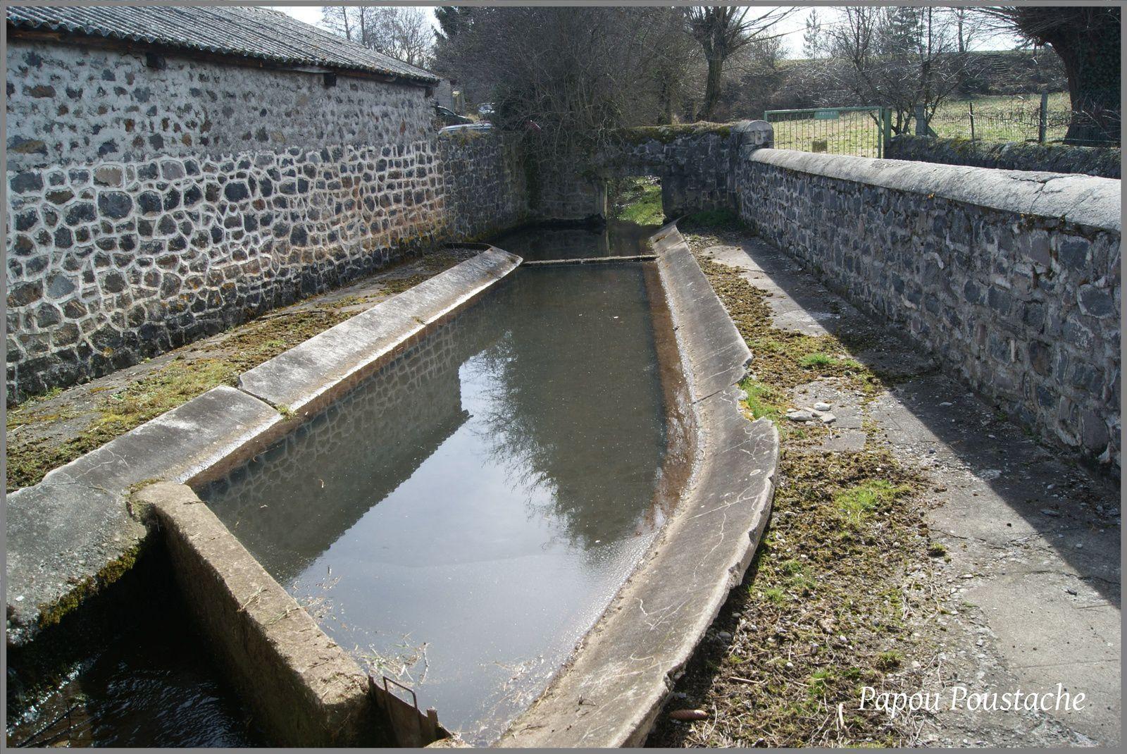 Les places,fontaines et croix à Solignac