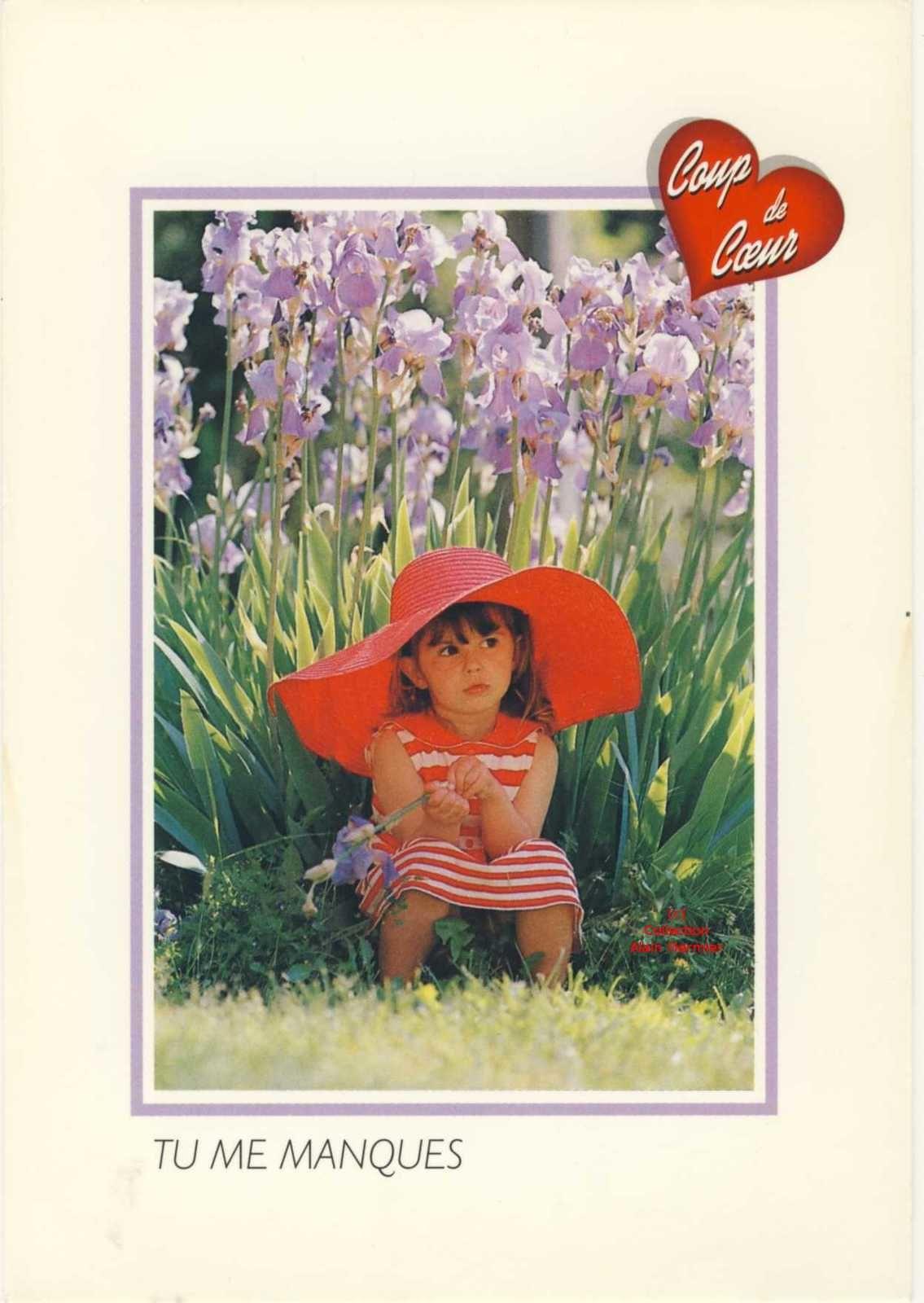 Iris -2274- CPM. Tu me manques. Fillette assise devant des iris.  France.