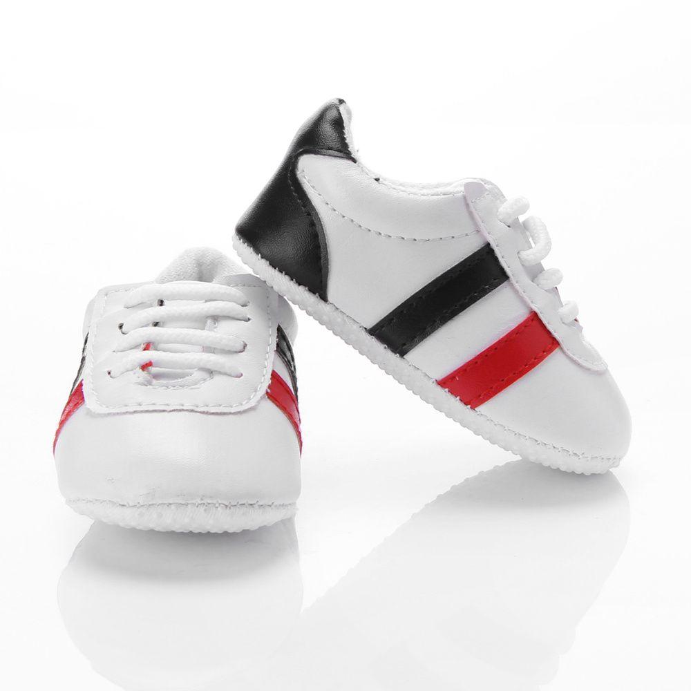 Baskets blanches bébé