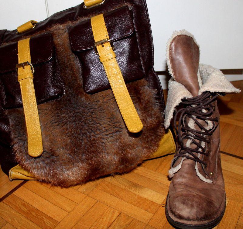 -Gilet (Cachecache) / -Jupe bandeau (H&M) / -Chemisier (H&M) / -Collant (Manor) / -Chaussures (Dosenbach) / -Bague (Cadeau) / -Boucle d'oreille (Particulier) / -Sac à main (Promod)