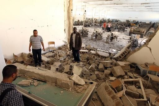 Les forces du général dissident Khalifa Haftar ont mené de nouveaux raids aériens contre les groupes islamistes radicaux dans la ville de Benghazi, ici la faculté d'ingénieurs, le 1er juin 2014 | AFP | Abdullah Doma - See more at: http://www.izf.net/afp/libye-raids-contre-les-islamistes-al-qa-da-appelle-combattre-g-n-ral-haftar#sthash.aulBJ01E.dpuf