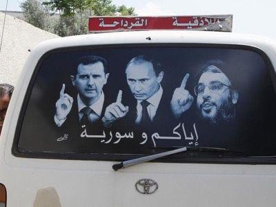 Autobus privé syrien décoré avec les portraits de Bachar el-Assad, Vladimir Poutine et Hassan Nasrallah, les trois hommes qui incarnent la Résistance à l'agression étrangère.