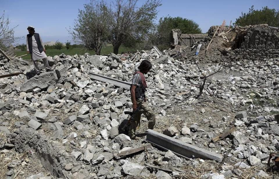 An Afghan security police officer at a destroyed house after an operation in Asad Khil near the site of a U.S. bombing in the Achin district of Jalalabad, east of Kabul, Afghanistan, April 17, 2017. U.S. forces in Afghanistan had struck an Islamic State tunnel complex in eastern Afghanistan earlier in the week with the largest non-nuclear weapon ever used in combat by the U.S. military, Pentagon officials said. Rahmat Gul AP.