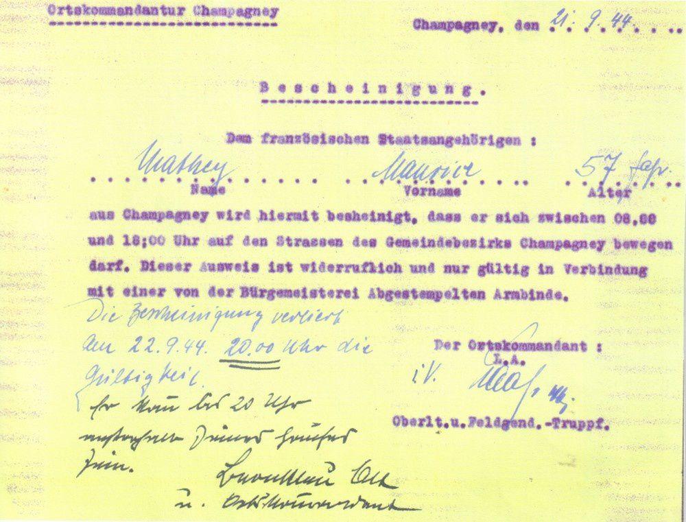 """Laissez-passer délivré à Maurice Mathey le 21 septembre 1944. On peut y lire : """" Le présent certificat atteste qu'il est autorisé à se déplacer sur les routes de Champagney de 8 h à 18 h. Ce laissez-passer est révocable et n'est valable qu'associé au port du brassard ... L'attestation perd sa validité le 22-09-44 à 20 heures."""""""