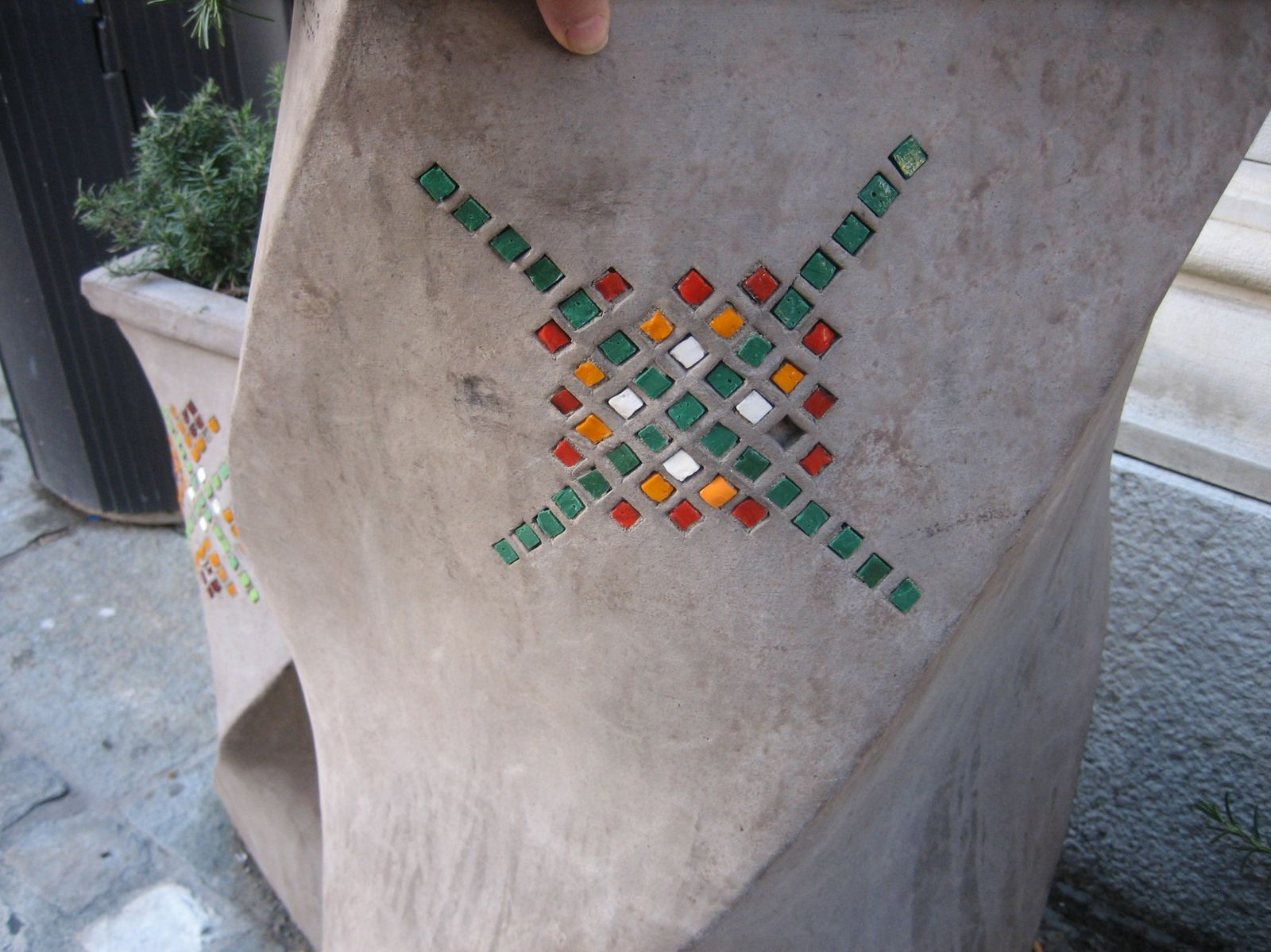 walking in Ravenna you can see mosaic in potteries