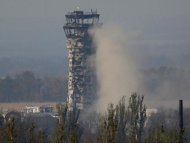A Ukrainian flag flies over the traffic control tower of Donetsk airport. Source: AP