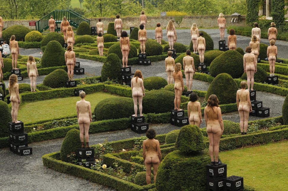 "Naked volunteers battle with pillows as they pose for U.S. artist Spencer Tunick in front of the Gaasbeek's Castle on July 9, 2011. Organizers estimated 800 people posed for the early morning nude photo installation titled ""Sleeping Beauties."""